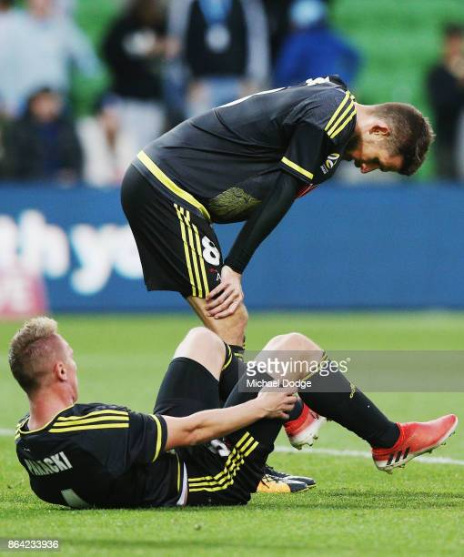 Dario Vidosic of Wellington Phoenix and Goran Paracki look dejected after defeat during the round three ALeague match between Melbourne City and the...