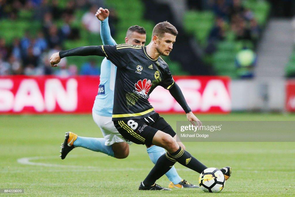 Dario Vidosic of Wellington Phoenix controls the ball from Manny Muscat during the round three A-League match between Melbourne City and the Wellington Phoenix at AAMI Park on October 21, 2017 in Melbourne, Australia.