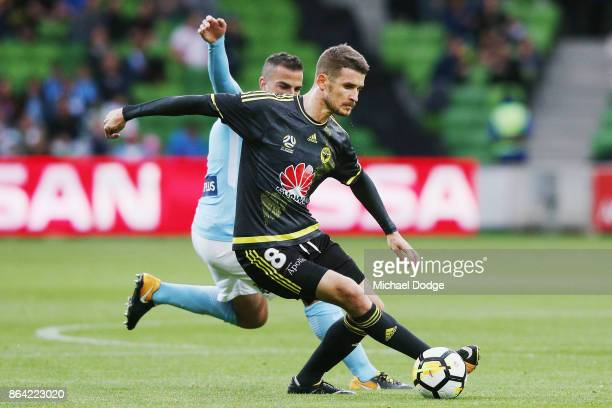 Dario Vidosic of Wellington Phoenix controls the ball from Manny Muscat during the round three ALeague match between Melbourne City and the...