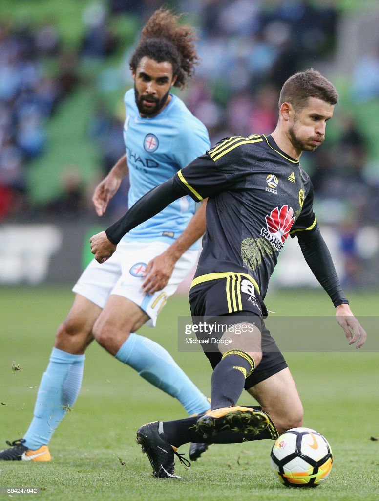 Dario Vidosic of Wellington Phoenix controls the ball from Osama Malik of the City during the round three A-League match between Melbourne City and the Wellington Phoenix at AAMI Park on October 21, 2017 in Melbourne, Australia.