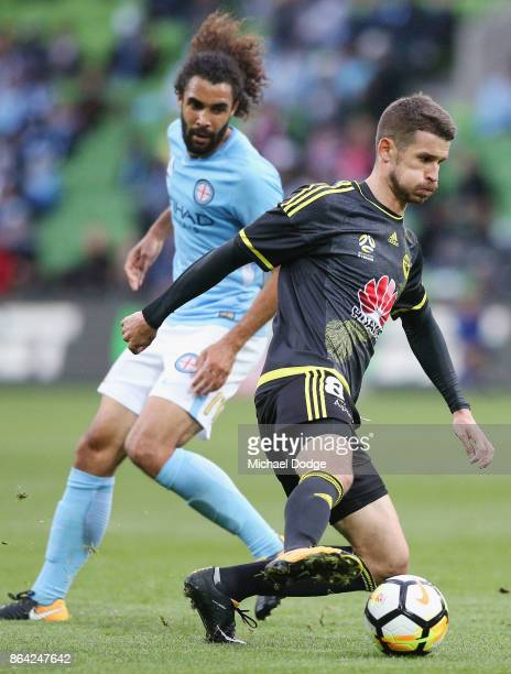 Dario Vidosic of Wellington Phoenix controls the ball from Osama Malik of the City during the round three ALeague match between Melbourne City and...