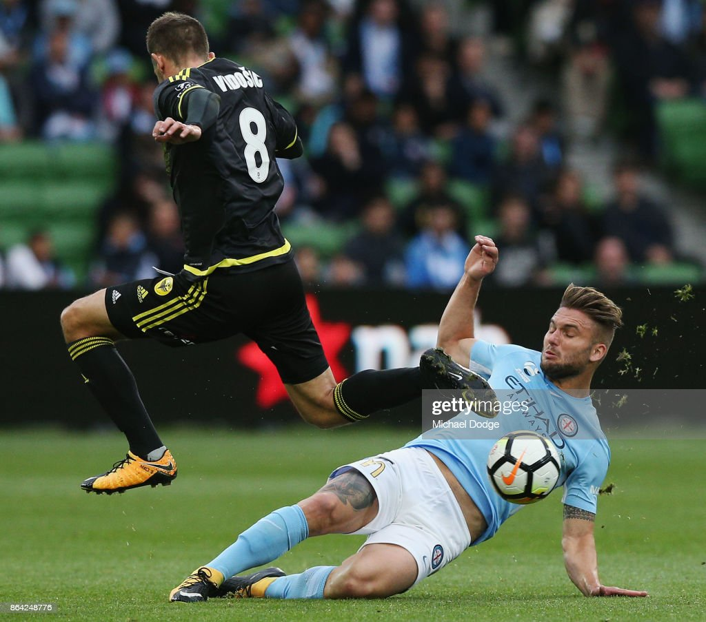 Dario Vidosic of Wellington Phoenix is tackled by Bart Schenkenveld of the City during the round three A-League match between Melbourne City and the Wellington Phoenix at AAMI Park on October 21, 2017 in Melbourne, Australia.