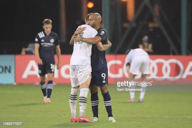 Dario Zuparic of Portland Timbers and Heber of New York City greet after a quarter final match of MLS Is Back Tournament at ESPN Wide World of Sports...