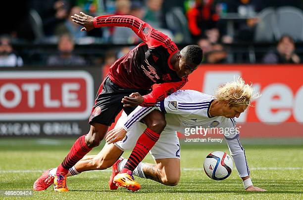 Darion Asprilla of the Portland Timbers battles Brek Shea of Orlando City SC at Providence Park on April 12 2015 in Portland Oregon