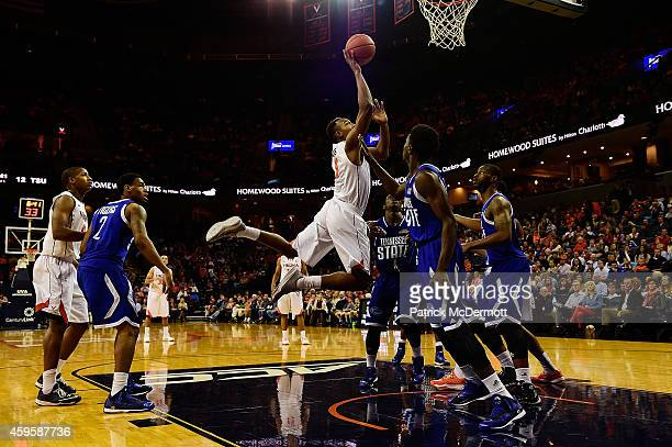 Darion Atkins of the Virginia Cavaliers drives to the basket in the first half against the Tennessee State Tigers during a game at John Paul Jones...