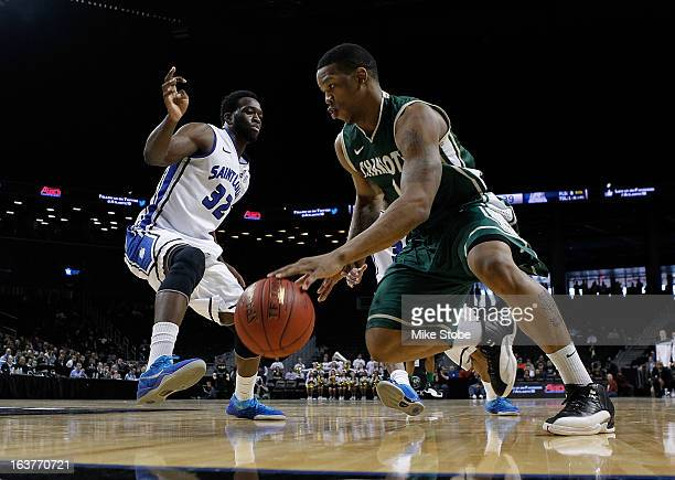 Darion Clark of the Charlotte 49ers drives to the net against Cory Remekun of the Saint Louis Billikens during the Quarterfinals of the Atlantic 10...