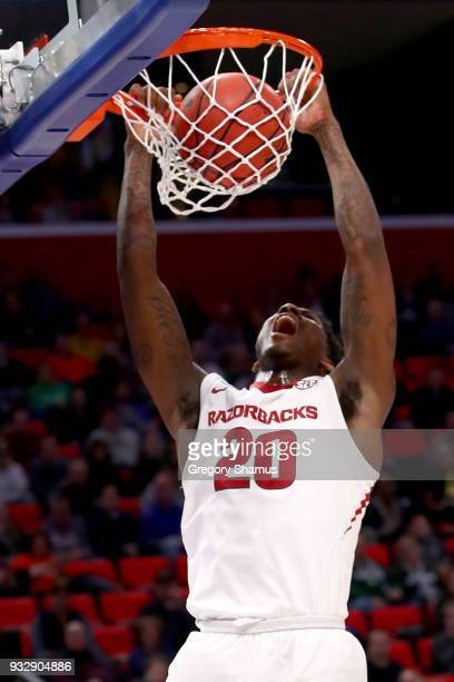 Darious Hall of the Arkansas Razorbacks dunks the ball against the Butler Bulldogs during the first half of the game in the first round of the 2018...