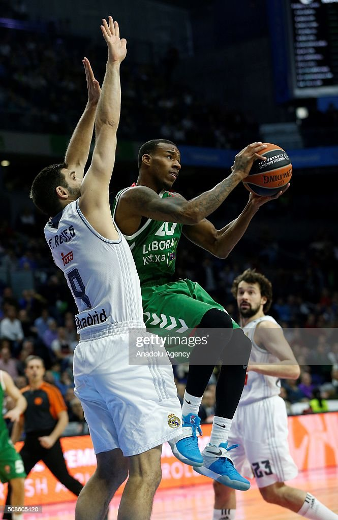 Darius Adams (R) of Laboral Kutxa Vitoria Gasteiz in action against Felipe Reyes of Real Madrid during the Turkish Airlines Euroleague Basketball Top 16 Round 6 game between Real Madrid v Laboral Kutxa Vitoria Gasteiz at Barclaycard Center on February 5, 2016 in Madrid, Spain.