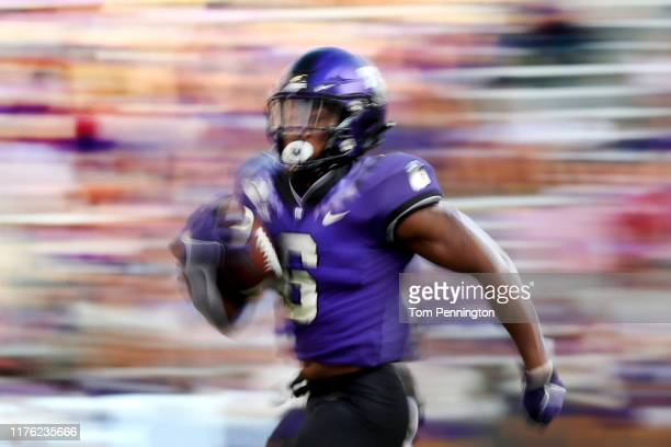 Darius Anderson of the TCU Horned Frogs carries the ball against the Southern Methodist Mustangs in the second half at Amon G Carter Stadium on...
