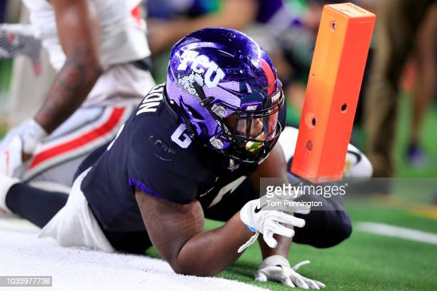 Darius Anderson of the TCU Horned Frogs scores a touchdown against the Ohio State Buckeyes in the third quarter during The AdvoCare Showdown at ATT...