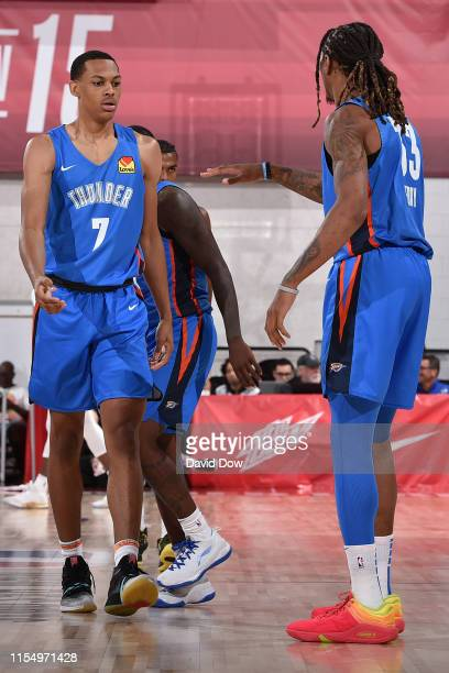 Darius Bazley and Emanuel Terry of the Oklahoma City Thunder hifive each other during the game against the Philadelphia 76ers on July 8 2019 at the...