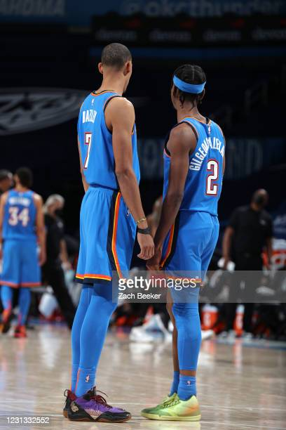 Darius Bazley and Shai Gilgeous-Alexander of the Oklahoma City Thunder look on during the game against the Miami Heat on February 22, 2021 at...