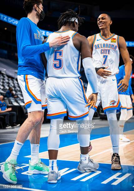 Darius Bazley hi-fives Luguentz Dort of the Oklahoma City Thunder during the game against the San Antonio Spurs on February 24, 2021 at Chesapeake...