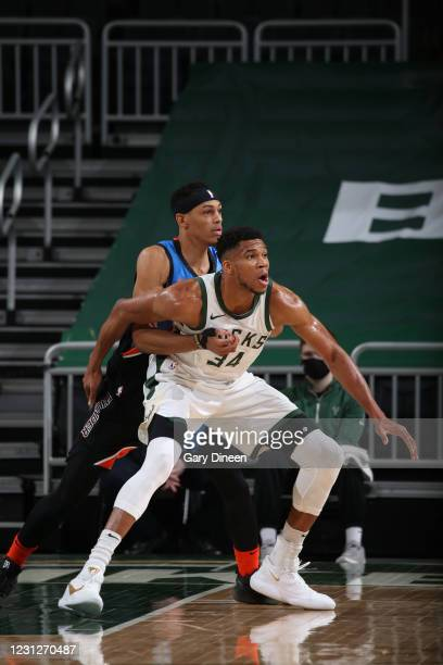 Darius Bazley of the Oklahoma City Thunder and Giannis Antetokounmpo of the Milwaukee Bucks fight for position during the game on February 19, 2021...