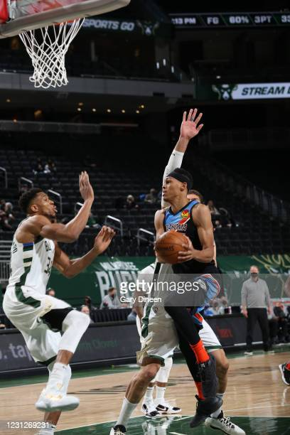 Darius Bazley of the Oklahoma City Thunder drives to the basket against the Milwaukee Bucks on February 19, 2021 at the Fiserv Forum Center in...