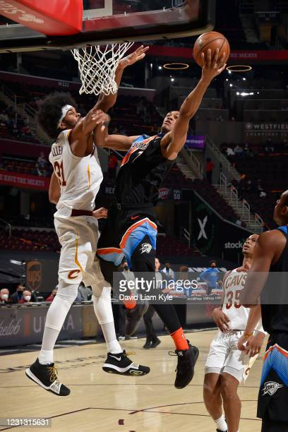 Darius Bazley of the Oklahoma City Thunder drives to the basket during the game against the Cleveland Cavaliers on February 21, 2021 at Rocket...