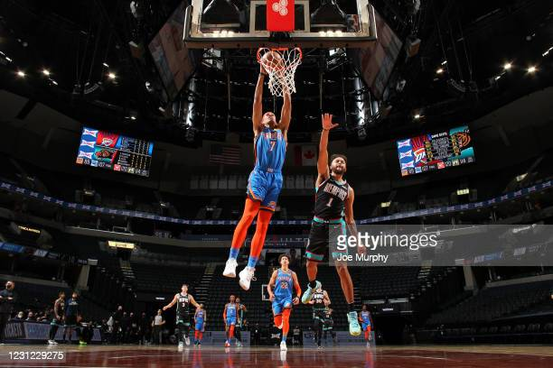 Darius Bazley of the Oklahoma City Thunder dunks the ball during the game against the Memphis Grizzlies on February 17, 2021 at FedExForum in...