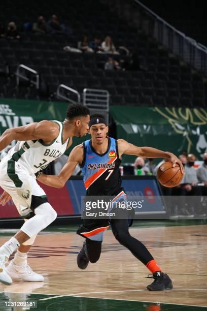 Darius Bazley of the Oklahoma City Thunder handles the ball against the Milwaukee Bucks on February 19, 2021 at the Fiserv Forum Center in Milwaukee,...