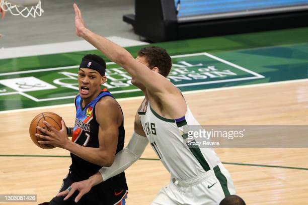 Darius Bazley of the Oklahoma City Thunder is defended by Brook Lopez of the Milwaukee Bucks during the first half of a game at Fiserv Forum on...