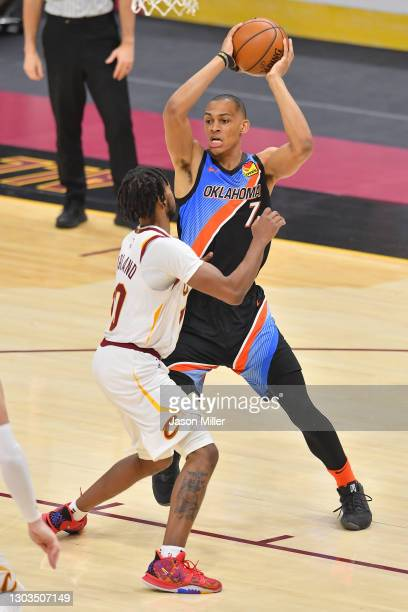 Darius Bazley of the Oklahoma City Thunder looks for a pass over Darius Garland of the Cleveland Cavaliers during the third quarter at Rocket...