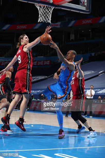 Darius Bazley of the Oklahoma City Thunder looks to passes the ball against the Miami Heat on February 22, 2021 at Chesapeake Energy Arena in...