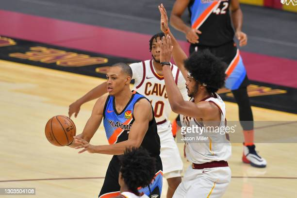 Darius Bazley of the Oklahoma City Thunder passes while under pressure from Jarrett Allen of the Cleveland Cavaliers during the fourth quarter at...