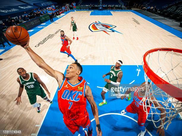 Darius Bazley of the Oklahoma City Thunder rebounds the ball during the game against the Milwaukee Bucks on February 14, 2021 at Chesapeake Energy...