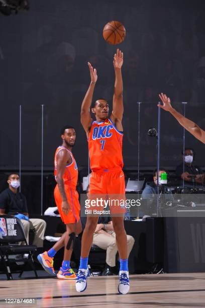 Darius Bazley of the Oklahoma City Thunder shoots three point basket against the Utah Jazz on August 1, 2020 at The Arena at ESPN Wide World of...