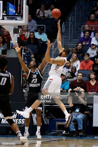 Darius Bolstad of the Radford Highlanders shoots the ball over the defense of Raiquan Clark of the LIU Brooklyn Blackbirds during the game at UD...