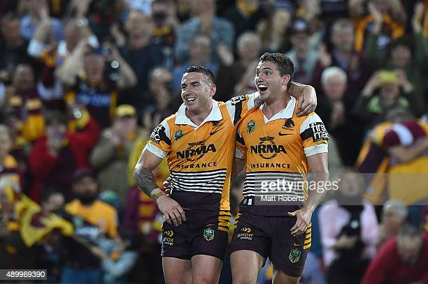 Darius Boyd and Corey Oates of the Broncos celebrate victory after the NRL First Preliminary Final match between the Brisbane Broncos and the Sydney...