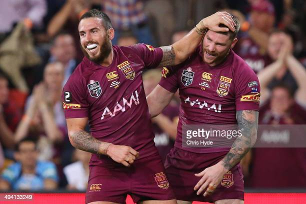 Darius Boyd celebrates with team mate Chris McQueen after scoring a try during game one of the State of Origin series between the Queensland Maroons...