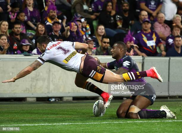 Darius Boyd of the Brisbane Broncos is challenged by Suliasi Vunivalu of the Storm during the NRL Preliminary Final match between the Melbourne Storm...