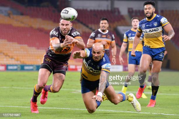 Darius Boyd of the Broncos and Blake Ferguson of the Eels contest the ball during the round three NRL match between the Brisbane Broncos and the...