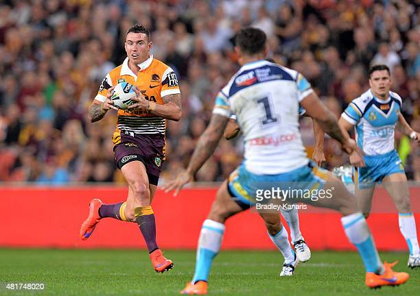 Darius Boyd of the Broncos breaks away from the defence during the round 20 NRL match between the Brisbane Broncos and the Gold Coast Titans at...