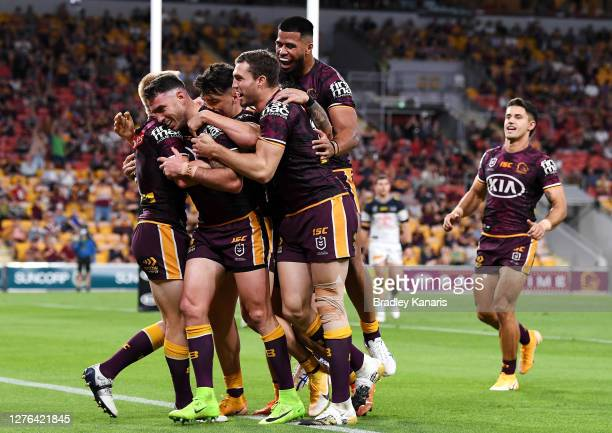 Darius Boyd of the Broncos celebrates scoring a try during the round 20 NRL match between the Brisbane Broncos and the North Queensland Cowboys at...