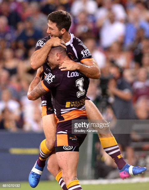Darius Boyd of the Broncos celebrates with Ben Hunt after scoring a try during the round two NRL match between the Brisbane Broncos and the North...