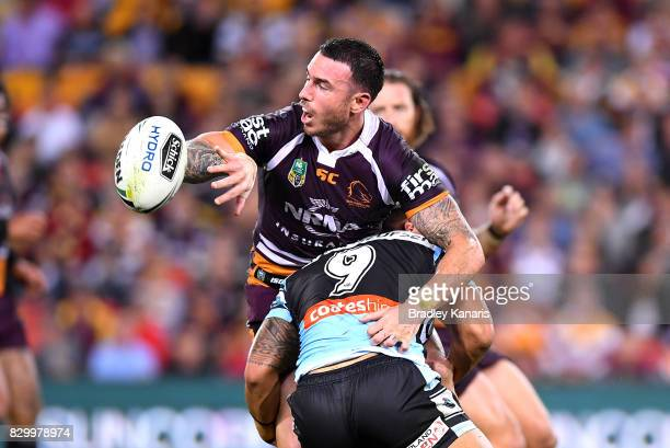 Darius Boyd of the Broncos gets a pass away during the round 23 NRL match between the Brisbane Broncos and the Cronulla Sharks at Suncorp Stadium on...