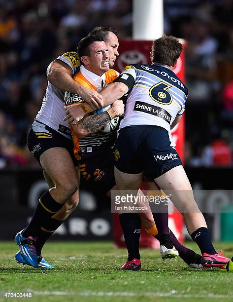Darius Boyd of the Broncos is tackled by Michael Morgan and Matthew Scott of the Cowboys during the round 10 NRL match between the North Queensland...