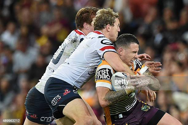 Darius Boyd of the Broncos is tackled during the NRL First Preliminary Final match between the Brisbane Broncos and the Sydney Roosters at Suncorp...