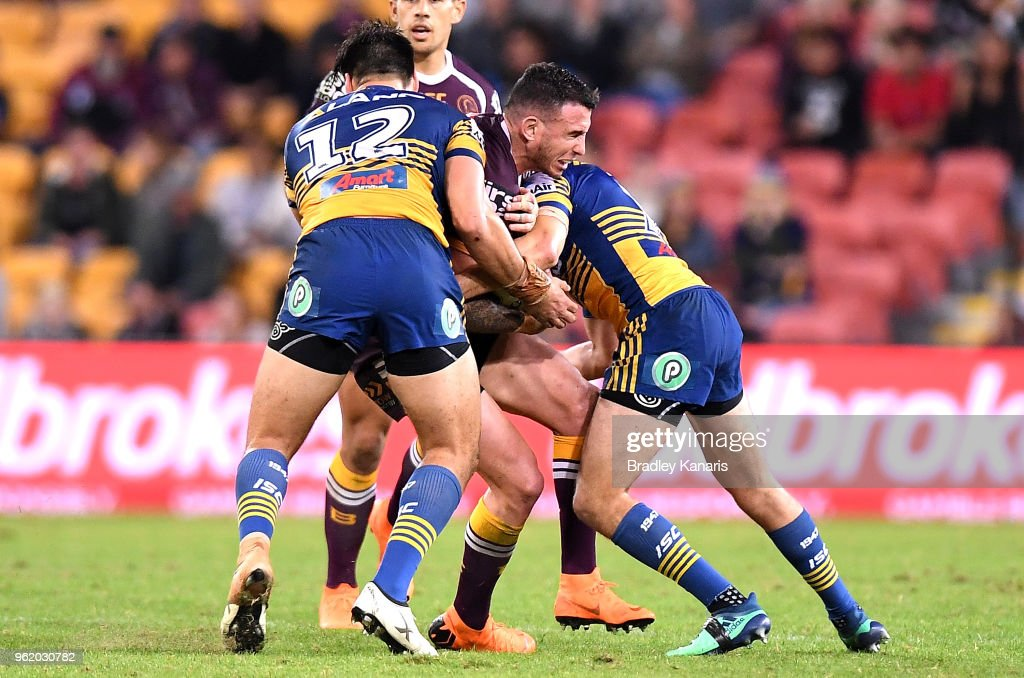 Darius Boyd of the Broncos is tackled during the round 12 NRL match between the Brisbane Broncos and the Parramatta Eels at Suncorp Stadium on May 24, 2018 in Brisbane, Australia.