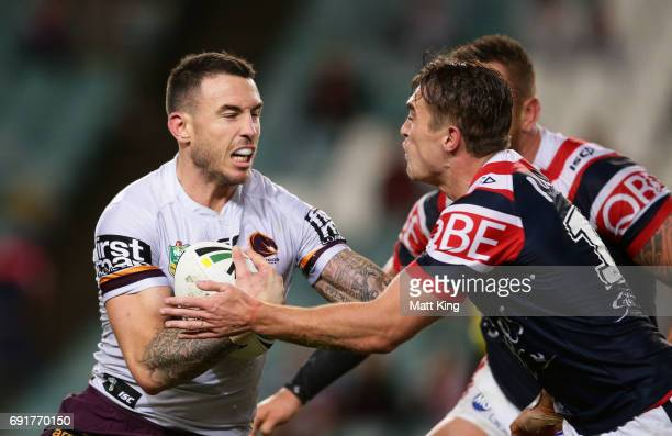 Darius Boyd of the Broncos is tackled during the round 13 NRL match between the Sydney Roosters and the Brisbane Broncos at Allianz Stadium on June 3...
