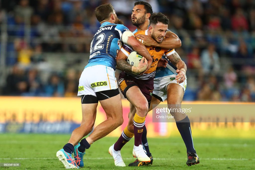 Darius Boyd of the Broncos is tackled during the round 17 NRL match between the Gold Coast Titans and the Brisbane Broncos at Cbus Super Stadium on July 8, 2018 in Gold Coast, Australia.