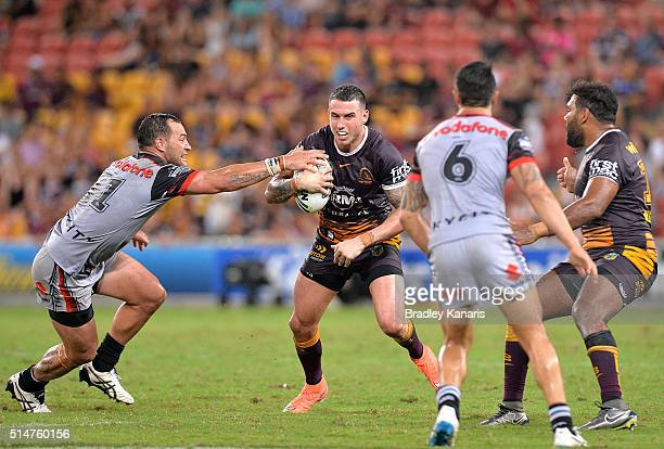 Darius Boyd of the Broncos looks to take on the defence during the round two NRL match between the Brisbane Broncos and the New Zealand Warriors at...