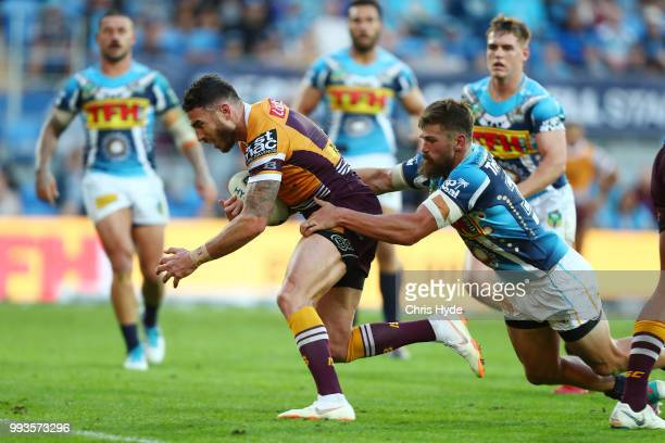 Darius Boyd of the Broncos makes a break to score a try during the round 17 NRL match between the Gold Coast Titans and the Brisbane Broncos at Cbus...