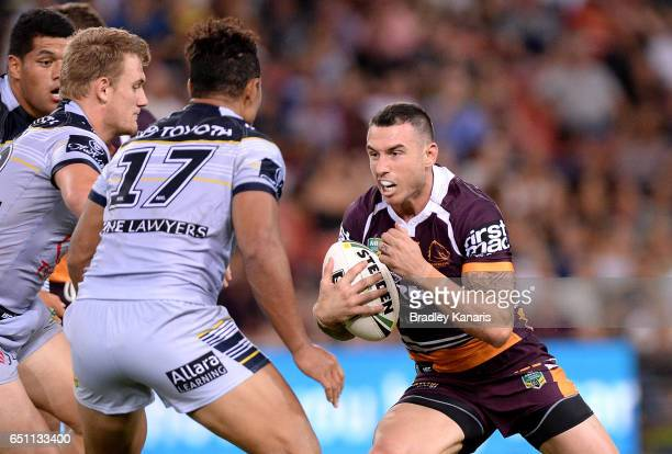Darius Boyd of the Broncos takes on the defence during the round two NRL match between the Brisbane Broncos and the North Queensland Cowboys at...