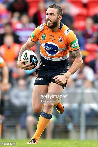 Darius Boyd of the Knights runs the ball during the round 13 NRL match between the Newcastle Knights and the Wests Tigers at Hunter Stadium on June 8...