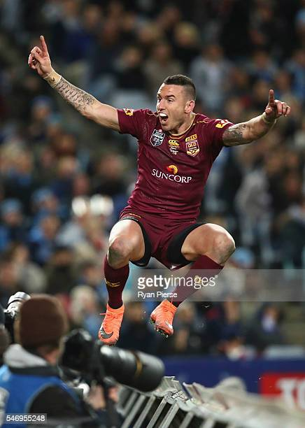 Darius Boyd of the Maroons celebrates after scoring a try during game three of the State Of Origin series between the New South Wales Blues and the...