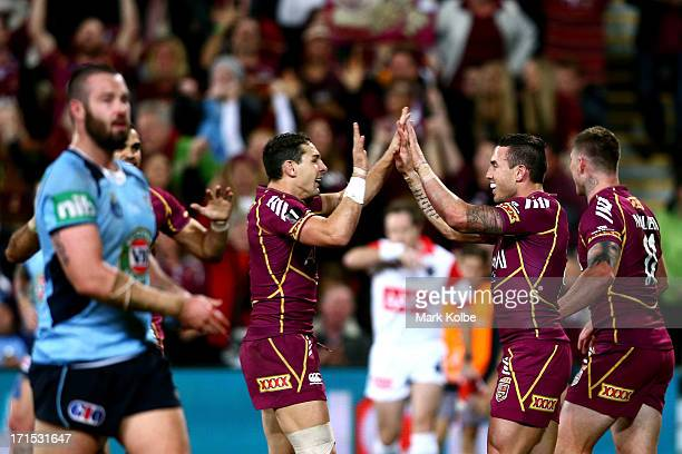 Darius Boyd of the Maroons celebrates scoring a try with team mate Billy Slater of the Maroons during game two of the ARL State of Origin series...