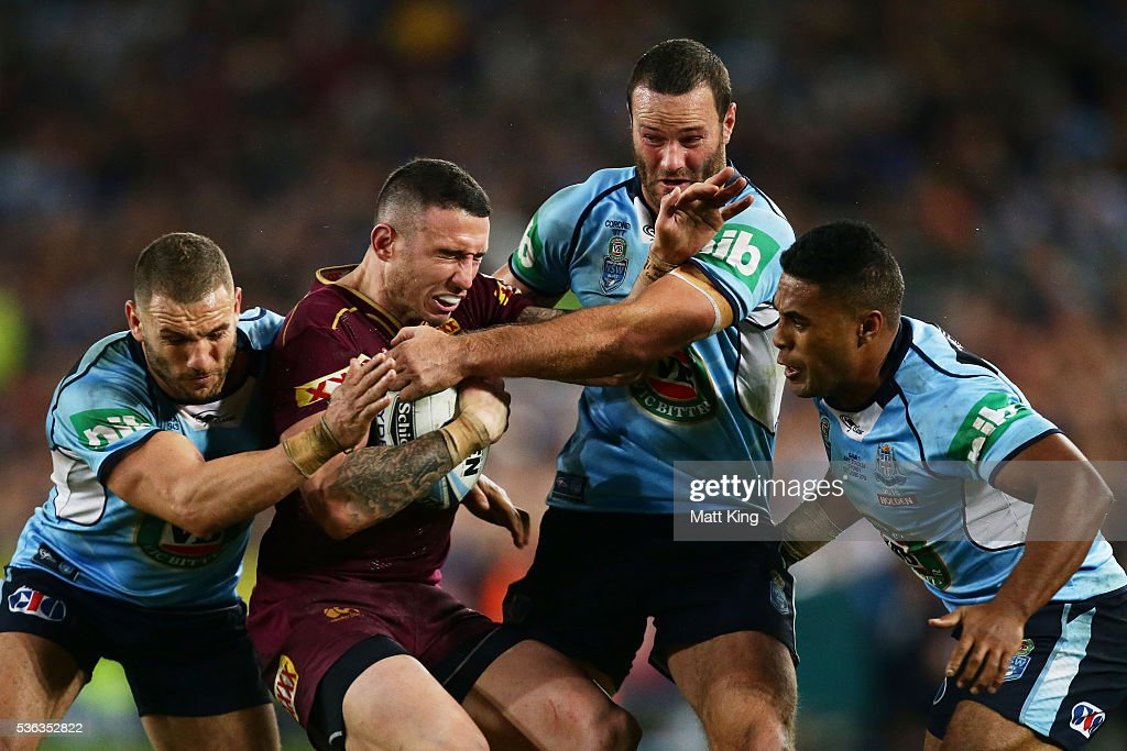 Darius Boyd of the Maroons is tackled during game one of the State Of Origin series between the New South Wales Blues and the Queensland Maroons at ANZ Stadium on June 1, 2016 in Sydney, Australia.