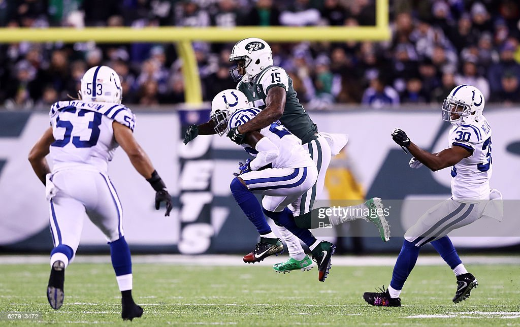Darius Butler #20 of the Indianapolis Colts intercepts a pass intended for Brandon Marshall #15 of the New York Jets in the second quarter during their game at MetLife Stadium on December 5, 2016 in East Rutherford, New Jersey.